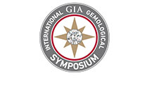 "Circular logo with the words ""International GIA Gemological Symposium"" around the outside and a star with a diamond center in the center circle."