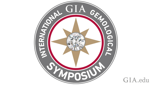 "Circular log with the words ""International GIA Gemological Symposium"" around the outside and a star with a diamond center in the center circle."