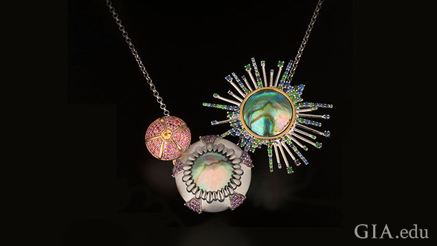 This urchin necklace is composed of two Eyris pearls accented with blue, pink and yellow sapphires, tsavorite garnets and amethysts.