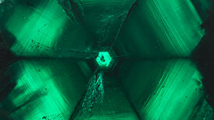 Looking down the crystal axis of a back-lit 58.83 ct trapiche emerald