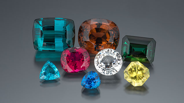 An array of multi-colored and multi-shaped elbaite tourmaline.