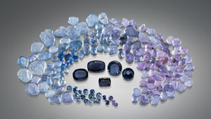 A group of rough sapphires encircle cut sapphires.