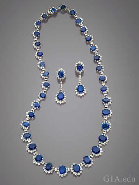 The sapphires in this necklace and earring set are all framed with diamonds.