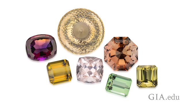 A group of seven gemstones.