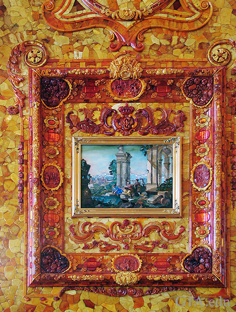 "Details of the Florentine mosaic ""Sight"" with a frame  fashioned from carved and sliced pieces of amber of various hues."