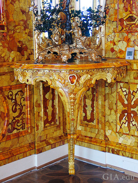 A corner section and end table shows the detail of the multi-hued recreated amber mosaics, the bas-relief with darker shades of amber, and the table itself, which is also coated with amber.
