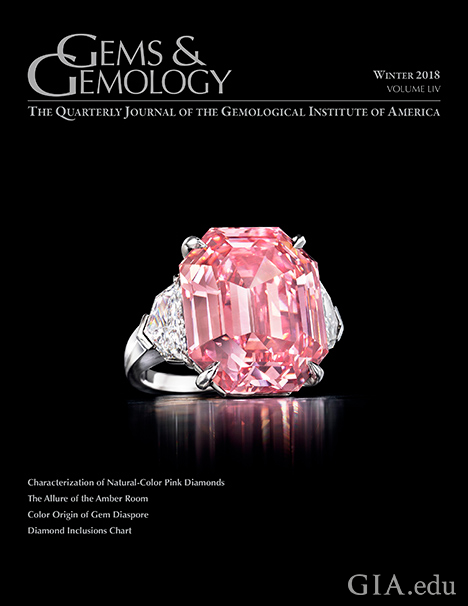 The cover of G&G magazine with a large pink diamond ring and cover lines.