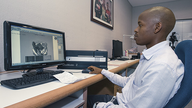 Employee uses new technology at Gabarone manufacturing plant