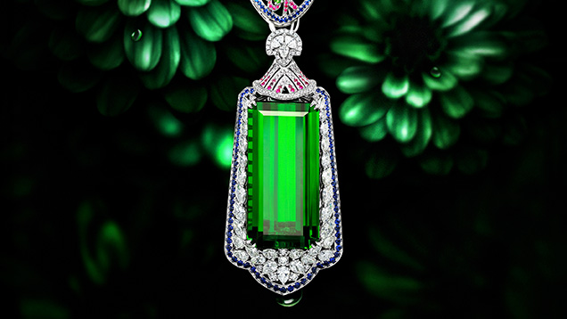 Emerald-cut green tourmaline with fancy cut diamonds, pink an green tourmaline, and blue sapphire necklace
