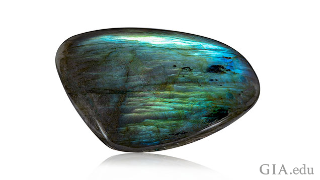 An elongated rectangle shape piece of labradorite.