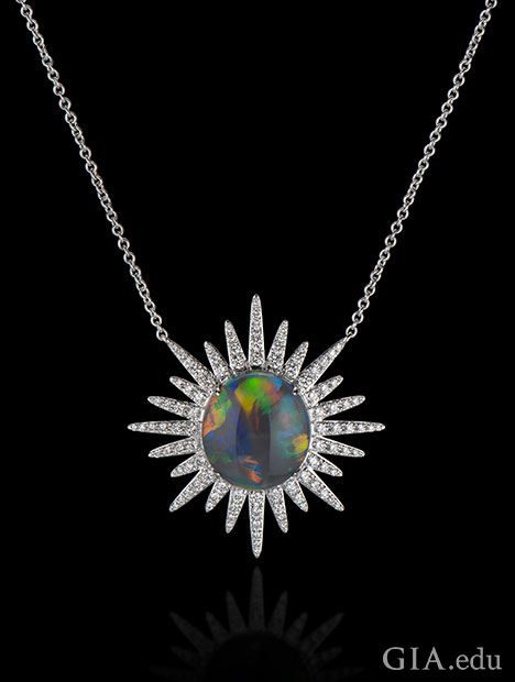 A 6.15 ct black opal in the center with 1.37 cts of diamonds radiating out in a starburst pattern. Set in 18kt white gold.