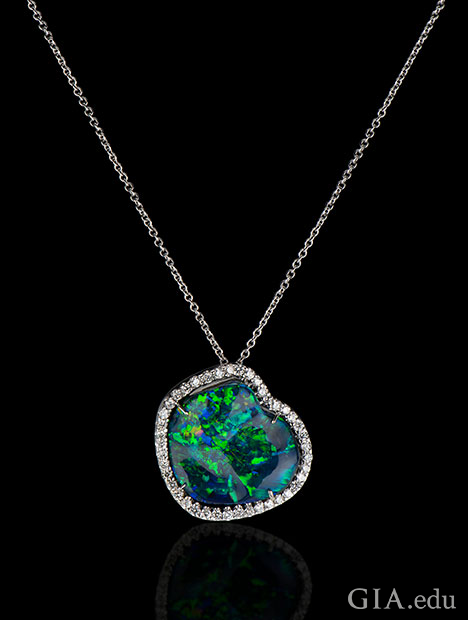 A 20.80 ct black opal set in 18kt white gold, accented with 1.26 cts of diamonds.