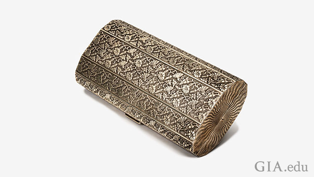 Silver fold-over clutch.