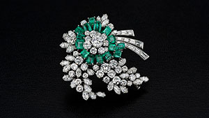 Emerald and diamond brooch.
