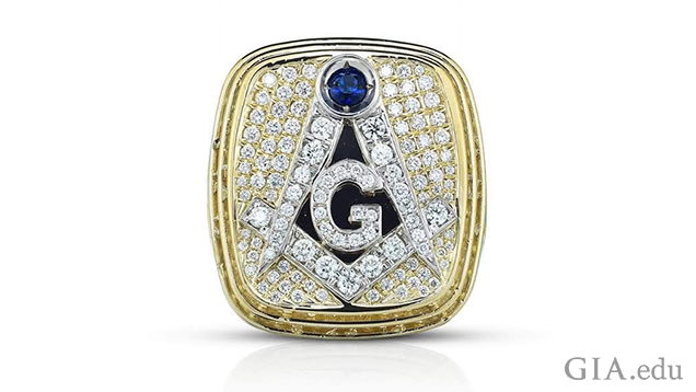 A square-shaped yellow and white gold ring with masonic symbols.