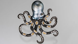 The octopus head is a baroque Tahitian cultured pearl and its arms are made of black, yellow and white diamond (in a striped pattern) set in black-plated 18K gold.