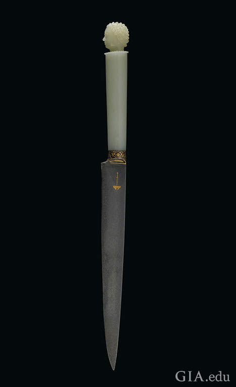 A white jadite dagger.