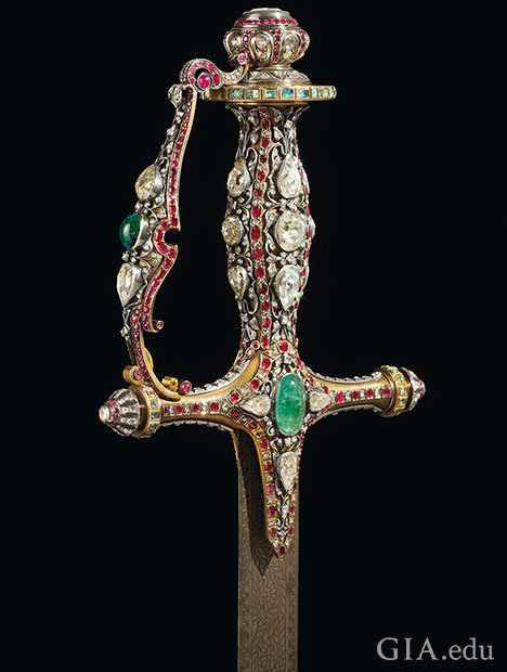 The handle of the sword is embellished with large traditional Mughal cut diamonds, rubies and emeralds.