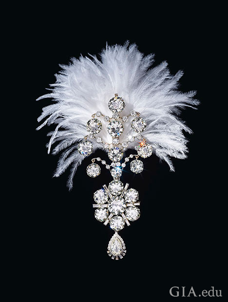 A diamond brooch topped with a white feather plume.