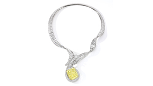 A diamond necklace that features a 100.02 Fancy Intense yellow diamond. The pendant is done in the shape of a musical instrument.