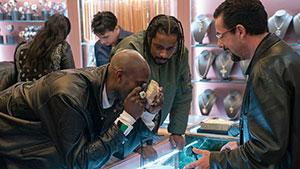 NBA star Kevin Garnett, left, plays himself in