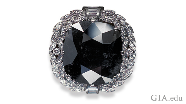 Image of Black Orloff diamond in a white gold setting surrounded by melee diamonds