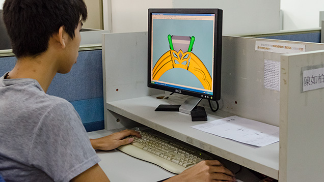 Worker using CAD/CAM to convert a hand drawing into a computer file