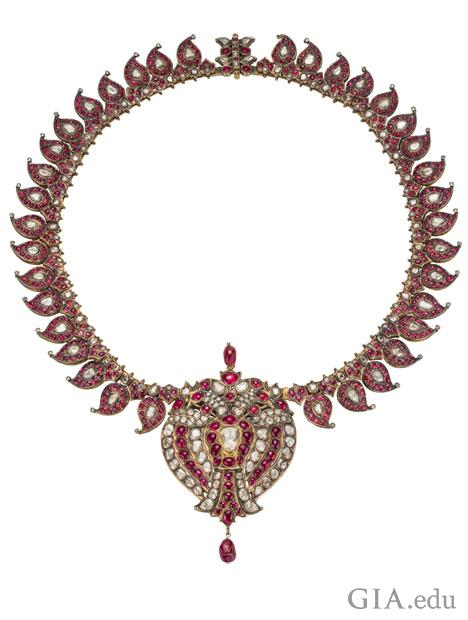 The Royal Manga Mala necklace exhibits mango shaped elements consisting of diamonds and rubies.