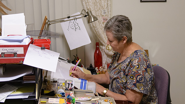 Woman sketching at desk