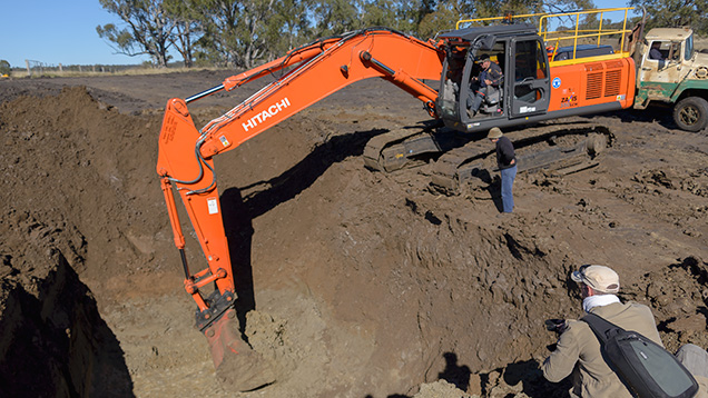 Excavator in an open-pit sapphire mine