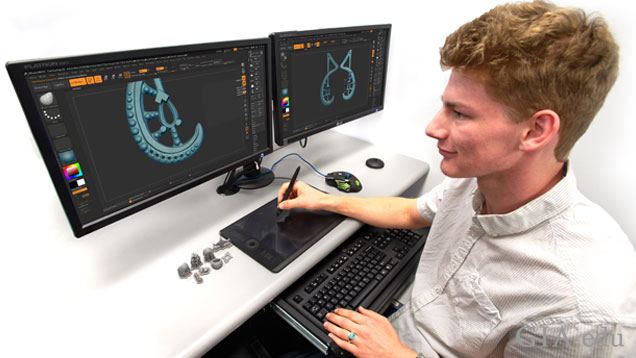 A student using Zbrush on a dual-monitor.