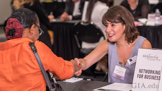 Michelle Orman shakes the hand of an eager job seeker during the one-on-one career coaching sessions.