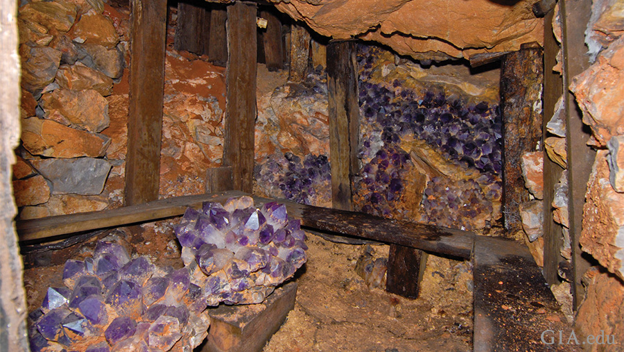 Large amethyst and ametrine crystals line the walls of Bolivia's historic Anahí mine, showcasing the February birthstone.