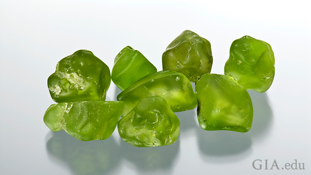 Eight pieces of peridot rough.