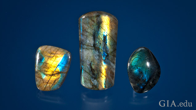 Three pieces of labradorite with yellow, blue and green flashes of colour.