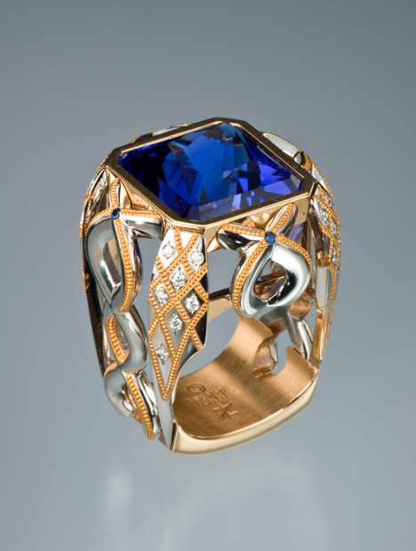 Intricate princess cut blue Tanzanite ring set in platinum inlay with gold accents