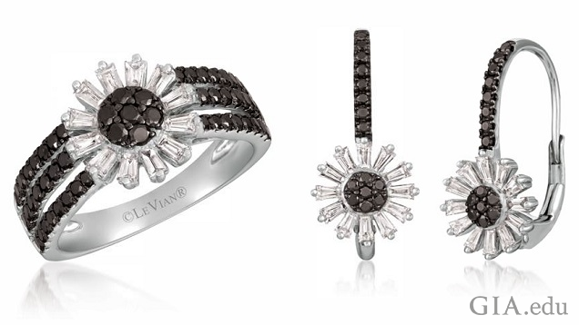 The ring is comprised of a sunflower motif with a black diamond center and colorless diamonds petals that sits on three bands of black diamonds. The sunflower motif, same as the ring, sits at the end of a row of black diamonds.