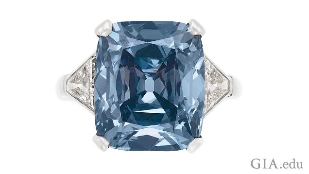 A Fancy Vivid blue diamond set in white metal ring