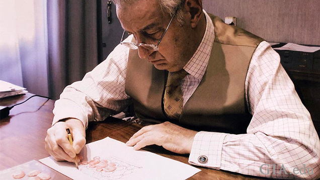 Gianmaria Buccellati hand sketching a jewellery design on paper.