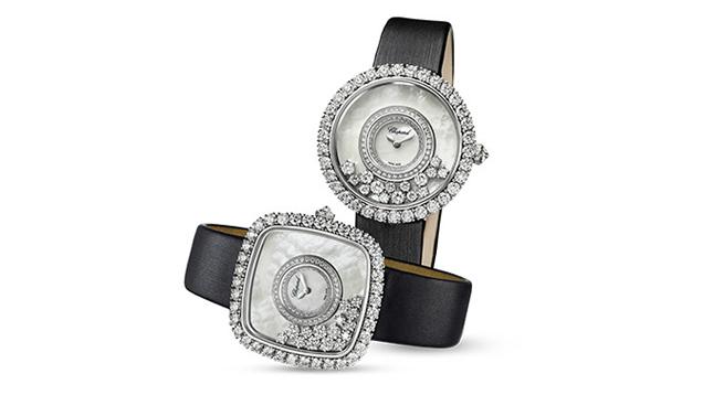 方形或圆形表盘以钻石点缀,展示了镶嵌于珠母贝表盘中的圆形明亮式钻石。 黑色织物表带。