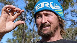 Man holding boulder opal