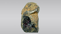 Rock crystal coated with brown skin.