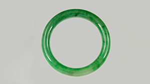 Jadeite jade and hydrogrossular garnet bangles.