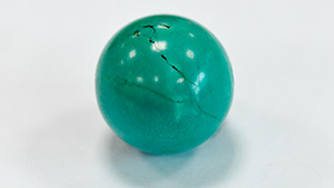 Dyed and impregnated turquoise.