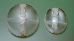 Quartz cabochons with cross-shaped quartz inclusions.