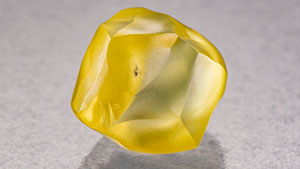 HPHT-processed yellow rough diamond.