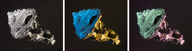 Sulfide inclusion in fluorite seen with Rhineberg illumination.