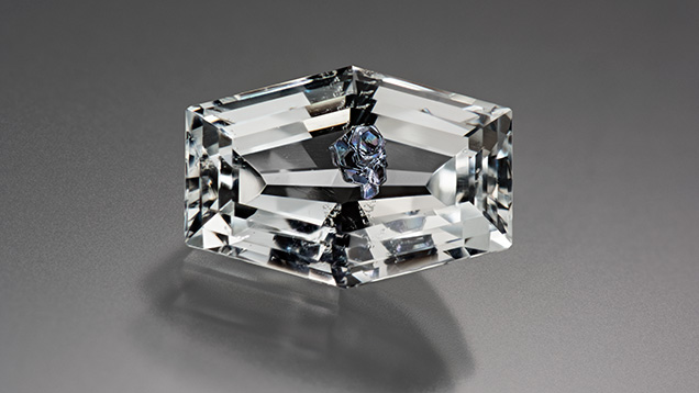 Brazilian colorless topaz with molybdenite inclusions.