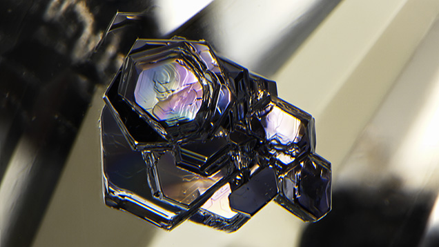 Molybdenite crystal inclusions in topaz.
