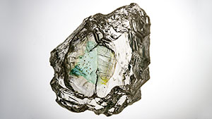 Rough diamond with green coloration along internal cleavage.